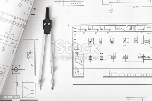 611108702 istock photo Engineering compass is on building plan. 610952084