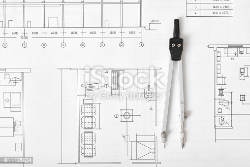 611108702 istock photo Engineering compass is on building plan. 611108604