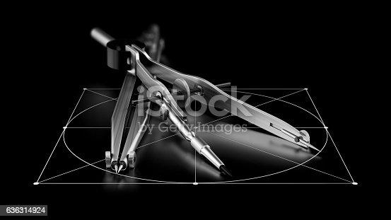 istock engineering compass on black background 636314924