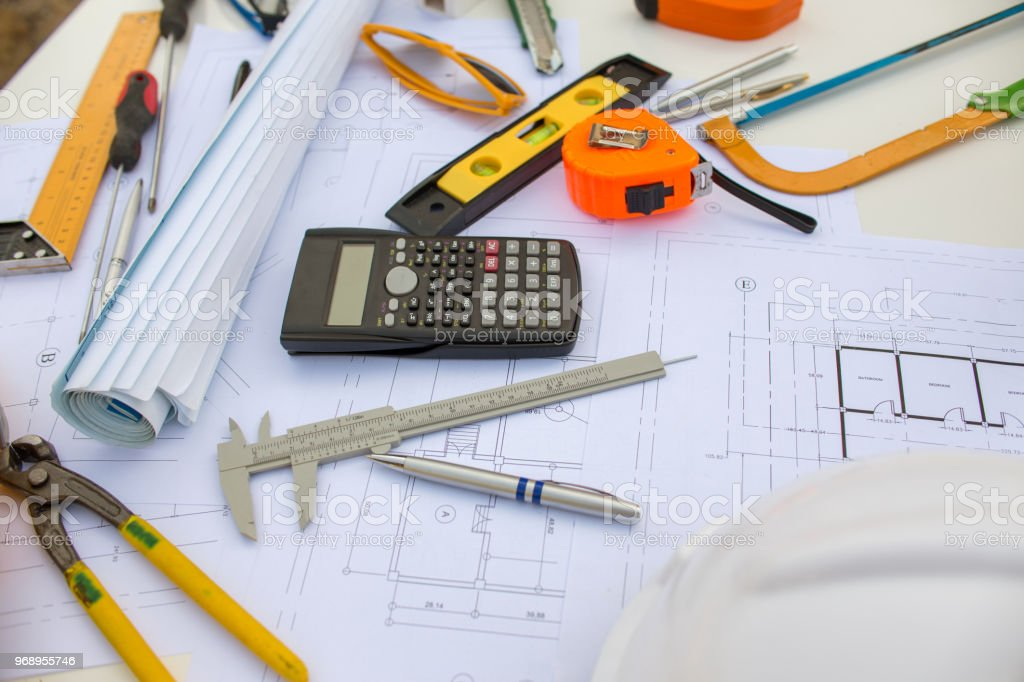 Engineering diagram blueprint paper drafting project sketch architectural. industrial drawing detail and several drawing tools stock photo