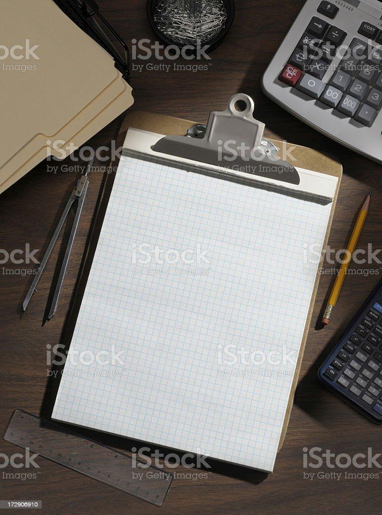 Engineering graph paper on desktop royalty-free stock photo