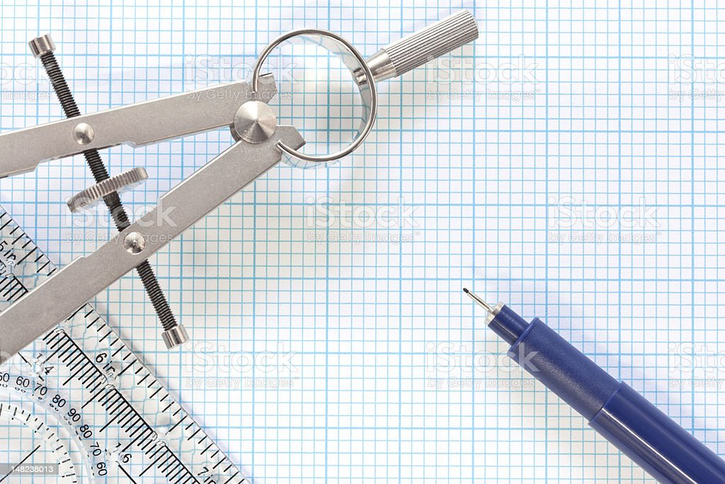 Engineering graph paper with compass and pen royalty-free stock photo