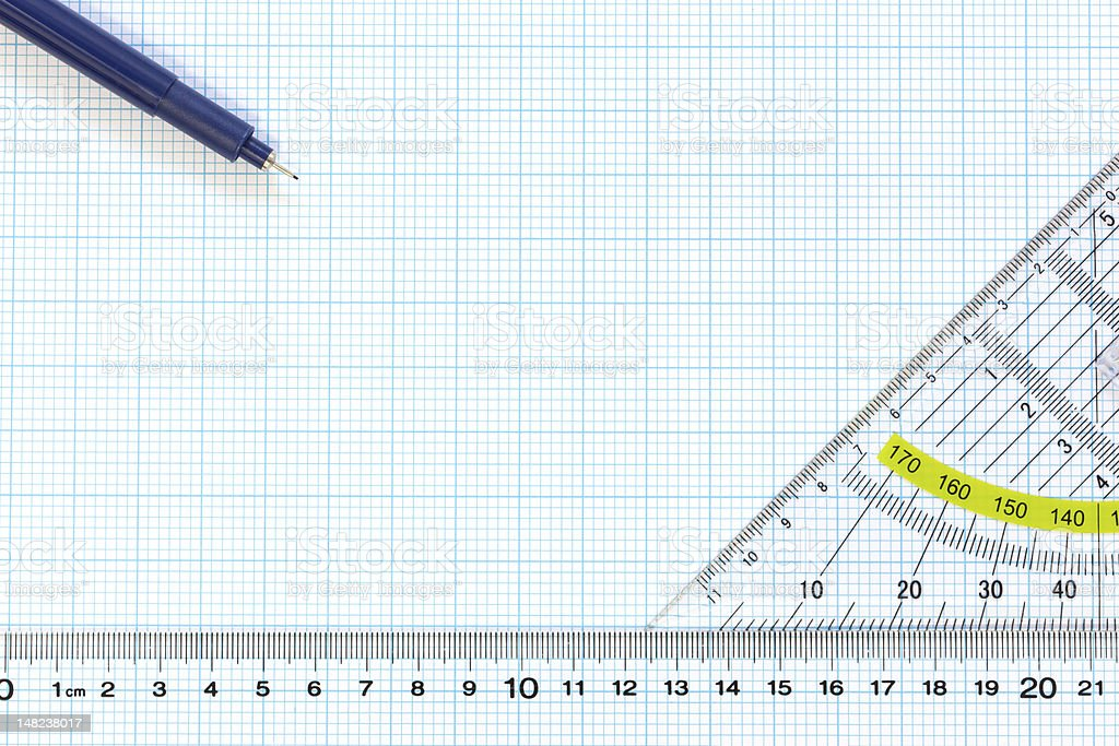 Engineering graph paper with ruler and pens royalty-free stock photo