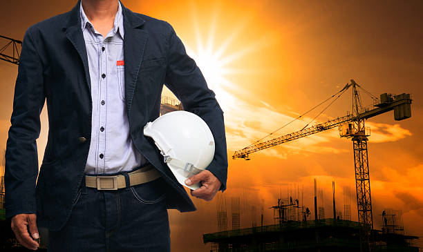 engineering man and construction site - civil engineer stock photos and pictures