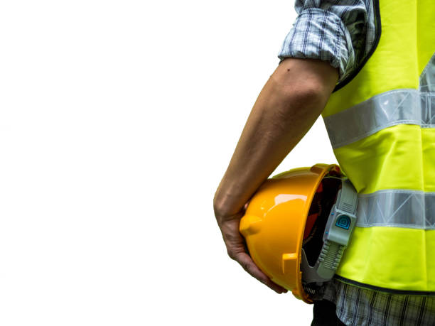 Engineering man standing with yellow safety helmet isolated on white background Engineering man standing with yellow safety helmet isolated on white background hardhat stock pictures, royalty-free photos & images
