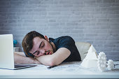 istock Engineering man working overwork and sleep on the desk with blueprint mechanical parts in office. having a bad stress and overwork concept 1069030610