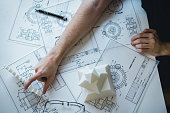 istock Engineering man's hand working with 3D printer's components and blueprint for designing mechanical parts . Engineering tools and  technology concept. 1069025160