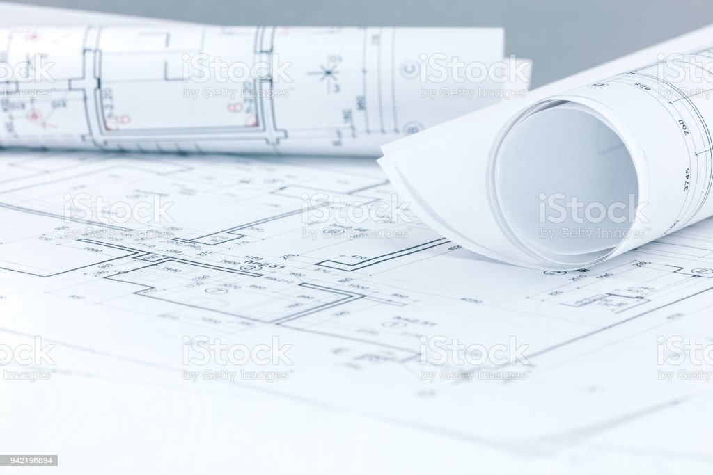 Engineering project plans and blueprint rolls on architect workplace blueprint construction industry desk document drawing activity malvernweather