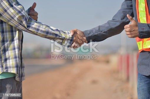 976560476 istock photo Engineering Shake hand success project teamwork road construction background,Hands Shake 1197398002