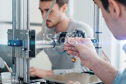 506677574 istock photo Engineering students using a 3D printer 1213441840