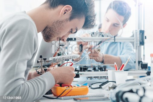 506677574 istock photo Engineering students working in the lab 1213441993