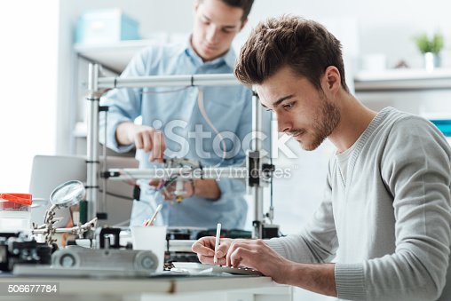 istock Engineering students working in the lab 506677784