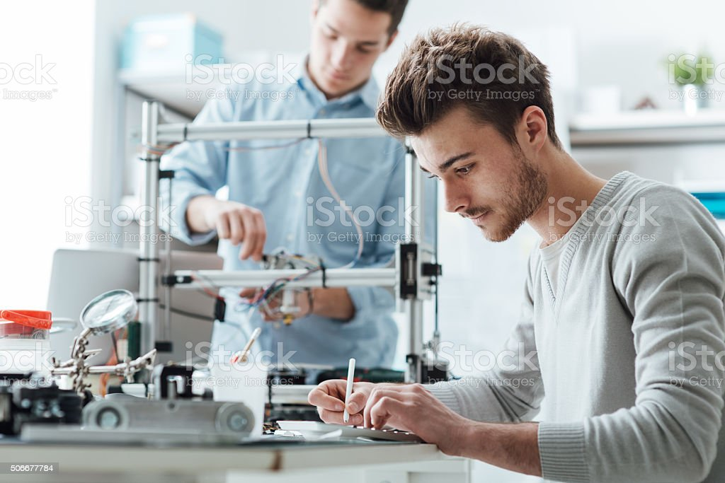 Engineering students working in the lab stock photo
