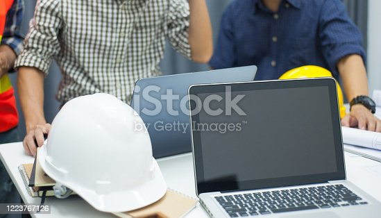 1170082011 istock photo Engineering team brainstorm, design and plan engineering projects. 1223767126