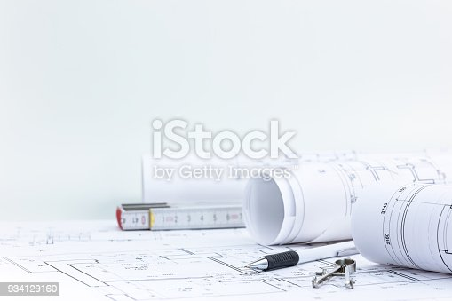 istock engineering tools with blueprint rolls and technical plan on architect workplace desk 934129160