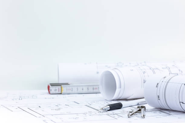 engineering tools with blueprint rolls and technical plan on architect workplace desk engineering and measuring tools, blueprint rolls with technical plan on architect workplace desk blueprint stock pictures, royalty-free photos & images