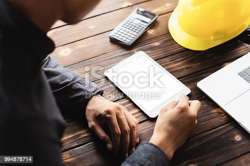 istock engineering using digital tablet on workspace 994878714