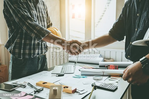istock Engineers and architects handshake. Agreement and are willing to work together. 1068877076