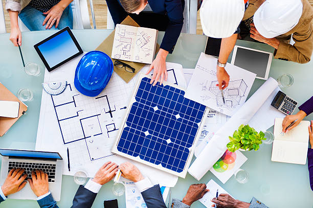 Engineers and Architects Planning for a New Project Engineers and Architects Planning for a New Project solar panels photos stock pictures, royalty-free photos & images