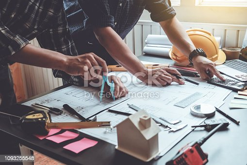 921019684istockphoto Engineers and architects, project planning together at the meeting. 1093255548