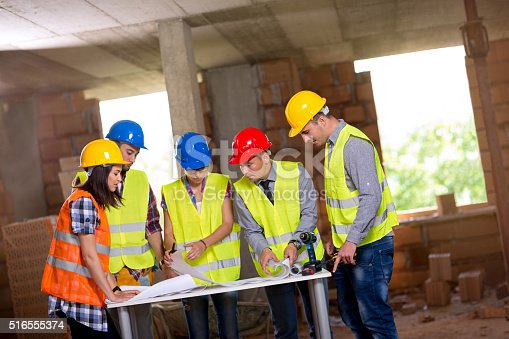 516607254istockphoto Engineers and architects working together 516555374