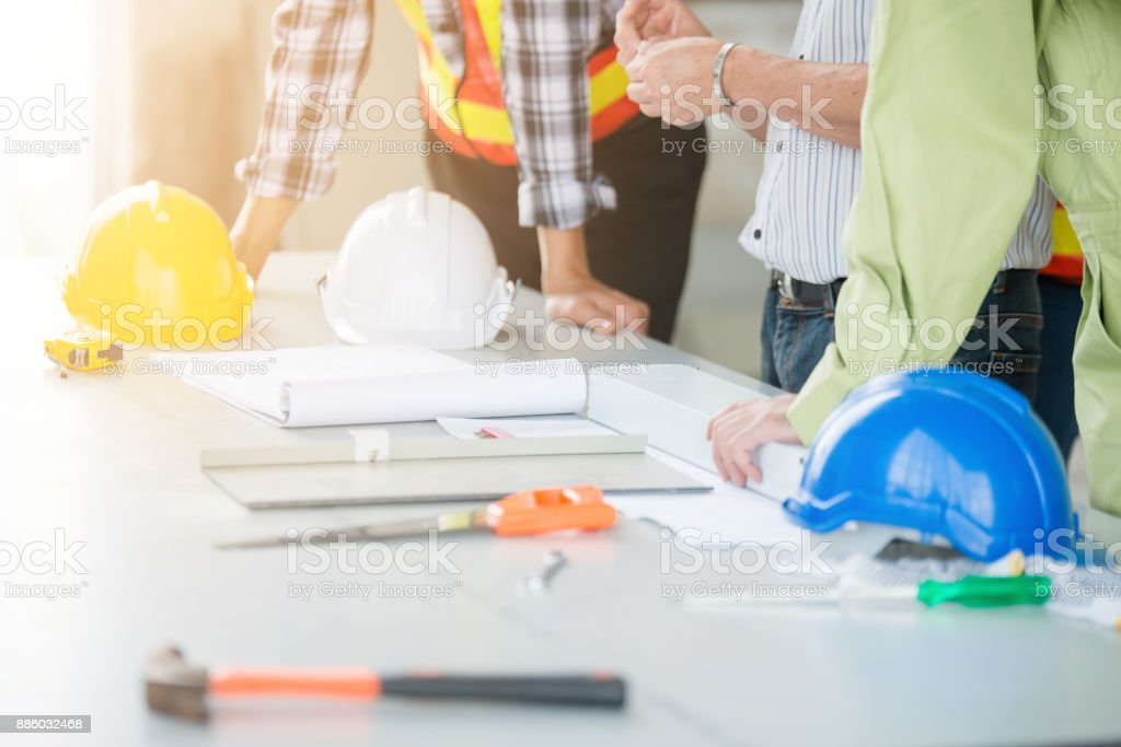 Engineers and foreman discuss stock photo
