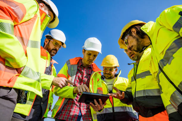 Engineers and workers assessing wastewater plant performance stock photo