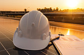 istock Engineers are examining the performance charts of energy production from solar panels that are alternative energy, which is the concept of sustainable resources 1145551709