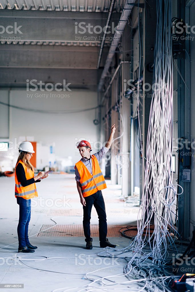 Engineers at construction site stock photo