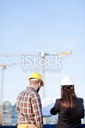 617878058 istock photo Engineers at construction site 544487990