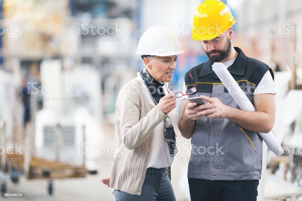 Engineers at work in factory stock photo