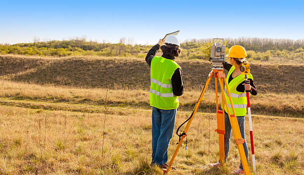 engineers at work - topography stock photos and pictures