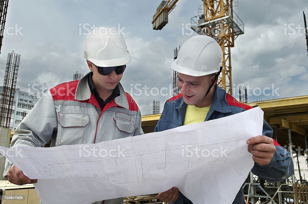 Engineers builders at construction site royalty-free stock photo
