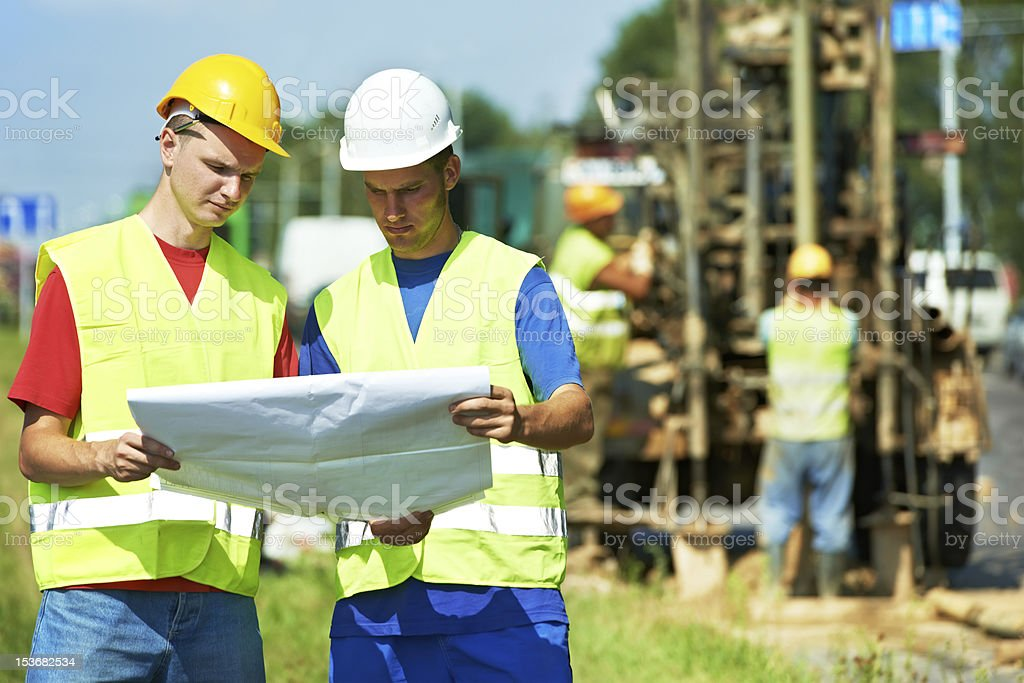 Engineers builders at road works construction site stock photo