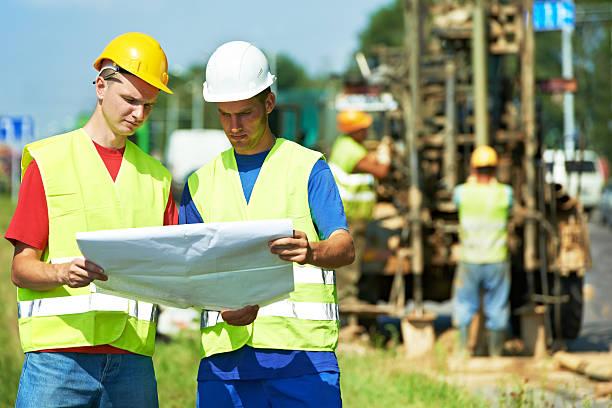 engineers builders at road works construction site - geologi bildbanksfoton och bilder