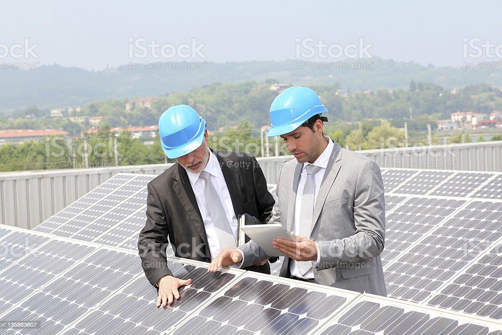 Engineers checking solar panels setup stock photo