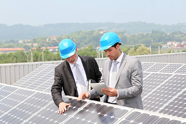 Engineers checking solar panels setup stock photo