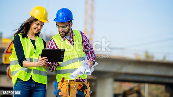 617878058istockphoto Engineers checking the progress at construction site 669709498