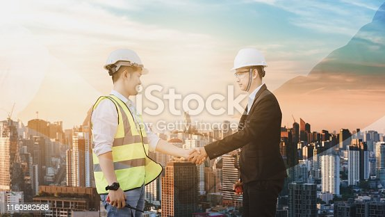 1071990712istockphoto Engineers cooperate with businessmen to agree to work together. 1160982568