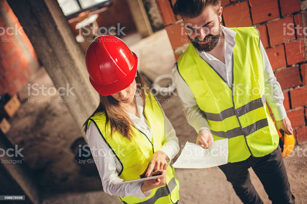 Engineers discusing about project stock photo