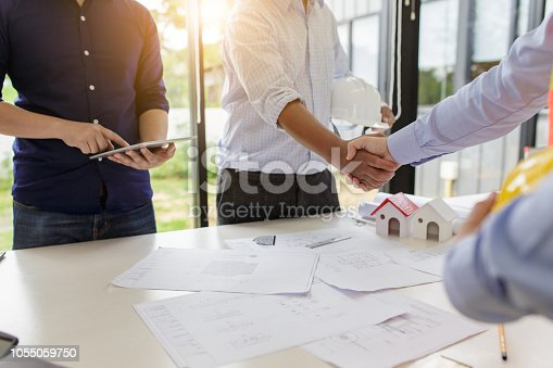 1055059750istockphoto Engineers handshake at meeting. Congratulations and agreed to do the project together. 1055059750