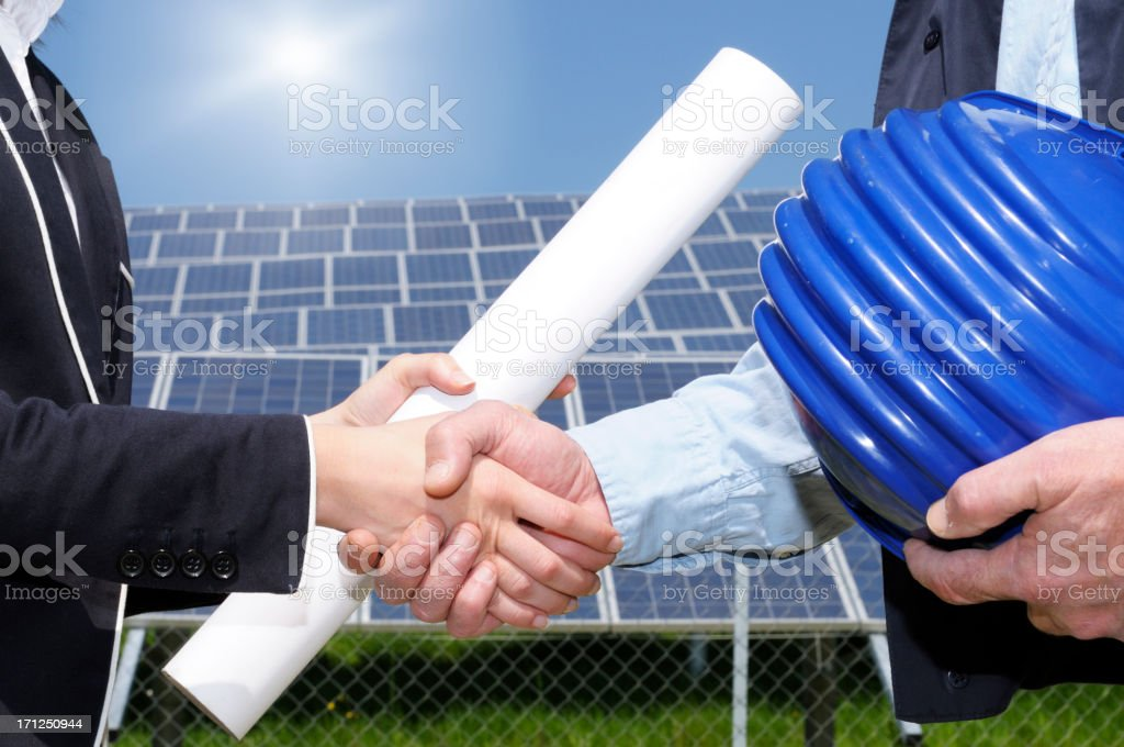 Engineers Handshaking in a Solar Power Station royalty-free stock photo