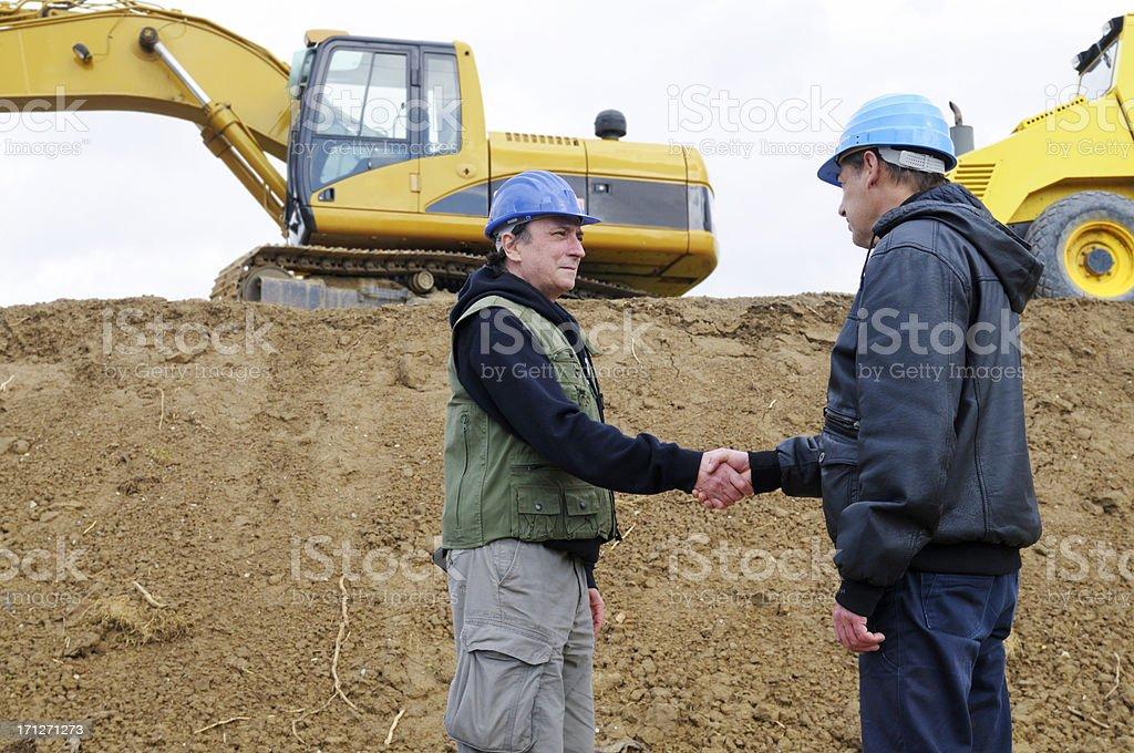 Engineers Handshaking royalty-free stock photo