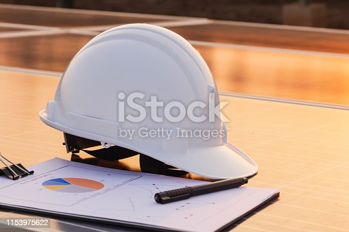 istock Engineers hat and the graph are placed on the solar panel, alternative electricity source, concept of sustainable resources 1153975622