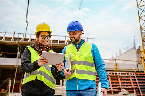Construction workers Using Digital Tablet on a construction site