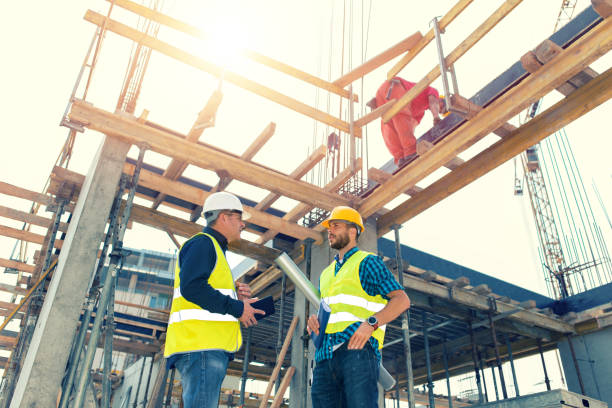 engineers having meeting regarding new construction phase - civil engineering stock pictures, royalty-free photos & images