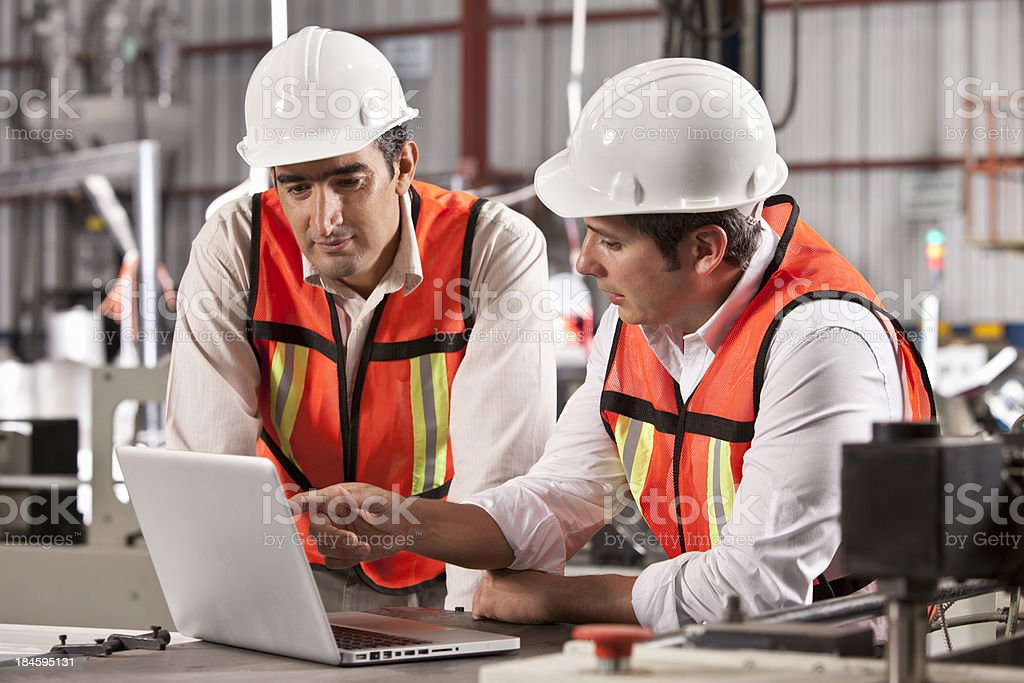 Engineers in Outsourcing Printing Industry stock photo