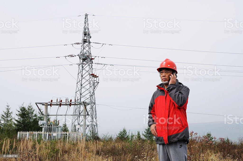 Engineers in thewind powerfieldof grassland stock photo