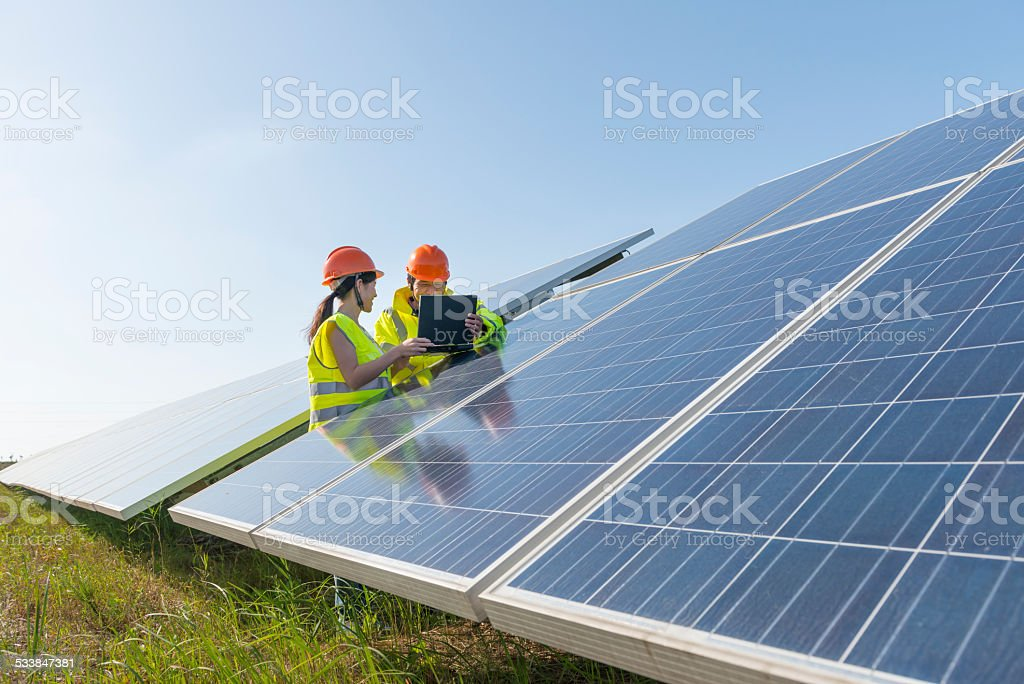 Engineers meeting at solar panel stock photo