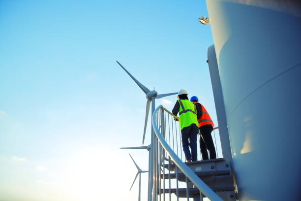 engineers of wind turbine - turbina a vento foto e immagini stock